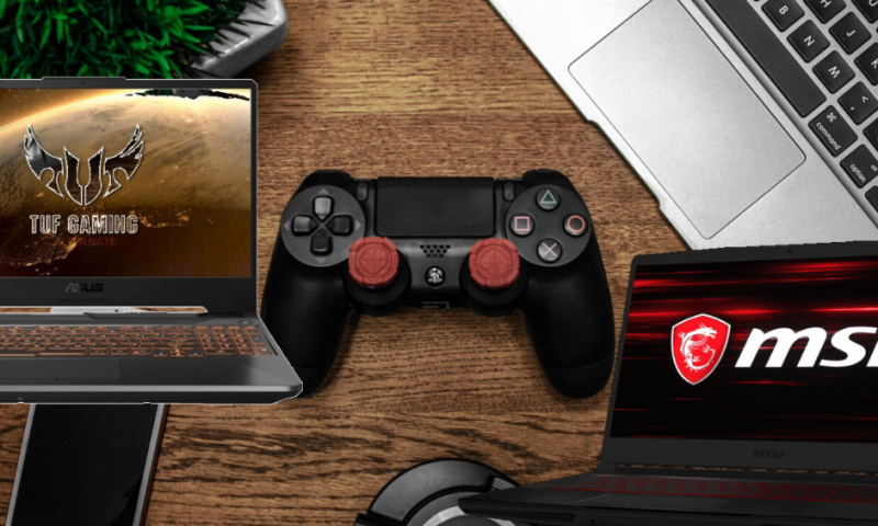 Laptops and controller on desk